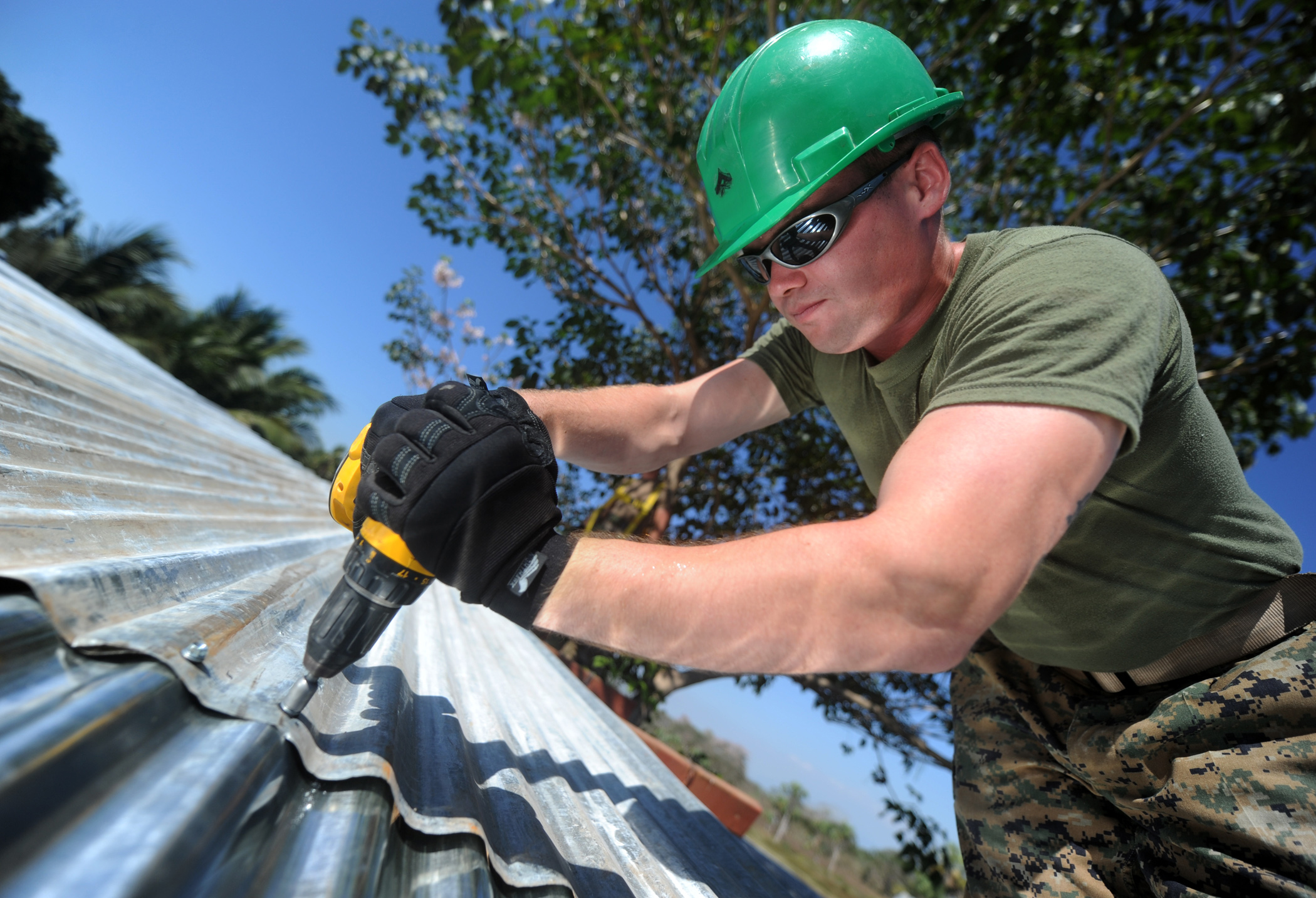 110131-N-2984R-220 U.S. Marine Corps Lance Cpl. Stephen S. Mcdonaldhale, assigned to the 2nd Marine Logistics Group, repairs the roof of a classroom at Escuela Santa Marta in San Jose, Guatemala, during a week-long project in support of Southern Partnership Station 2011 on Jan. 31, 2011. Southern Partnership Station is an annual deployment of U.S. ships to the U.S. Southern Command area of responsibility in the Caribbean and Latin America involving information sharing with navies, coast guards and civilian services throughout the region. DoD photo by Petty Officer 2nd Class Ricardo J. Reyes, U.S. Navy. (Released)